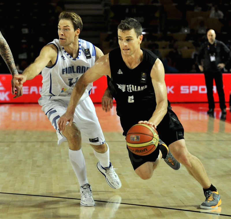 Kirk Penney (R) of New Zealand drives the ball during the group C game against Finland at the 2014 FIBA Basketball World Cup, in Bilbao, Spain, on Sept. 4, 2014.  ...