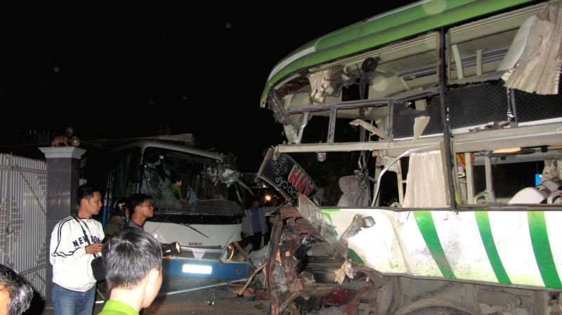 Photo taken on Feb. 9, 2015 shows the accident site in Binh Thuan Province, central Vietnam. At least 10 people were killed and dozens of others injured in a ...