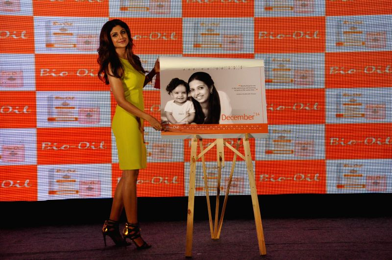Bio Oil Yummy Mummy Shilpa Shetty unveiling the Bio Oil Yummy Mummy calendar during the launch of The Yummy Mummy Calender in Mumbai on May 8, 2014.