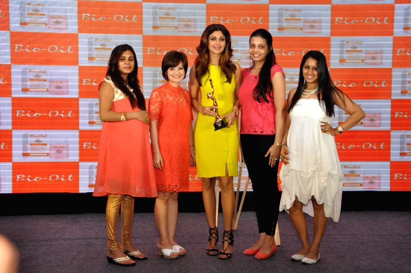 Bio Oil Yummy Mummy Shilpa Shetty with Bio Oil yummy Mummy calendar winners during the launch of The Yummy Mummy Calender in Mumbai on May 8, 2014.