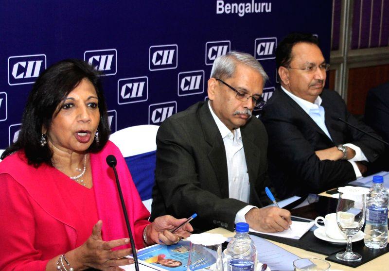 Biocon CMD Kiran Mazumdar Shaw with Infosys co-founder Kris Gopalakrishnan and Toyota Kirloskar Motor Vice Chairman Vikram Kirloskar addresses during an interactive session on Union Budget ...