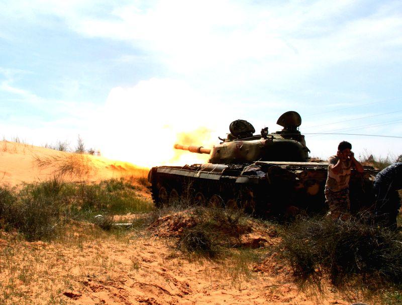 BIR AL-A Libya Dawn tank fires to their enemies near Bir al-Ghanam, Libya, on March 19, 2015. Clashes continued between Libya Dawn fighters and pro-government ...