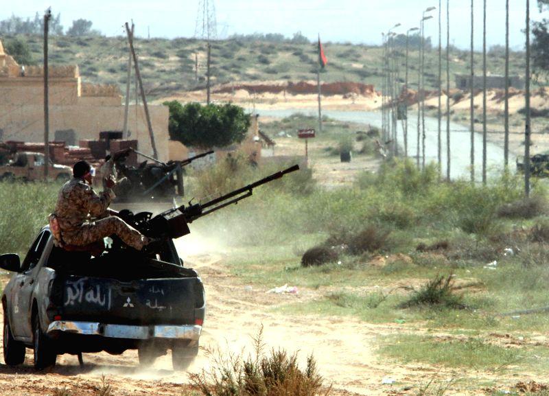 BIR AL-Some Libya Dawn fighters go into the combat zone on their armed vehicles near Bir al-Ghanam, Libya, on March 19, 2015. Clashes continued between Libya Dawn ...