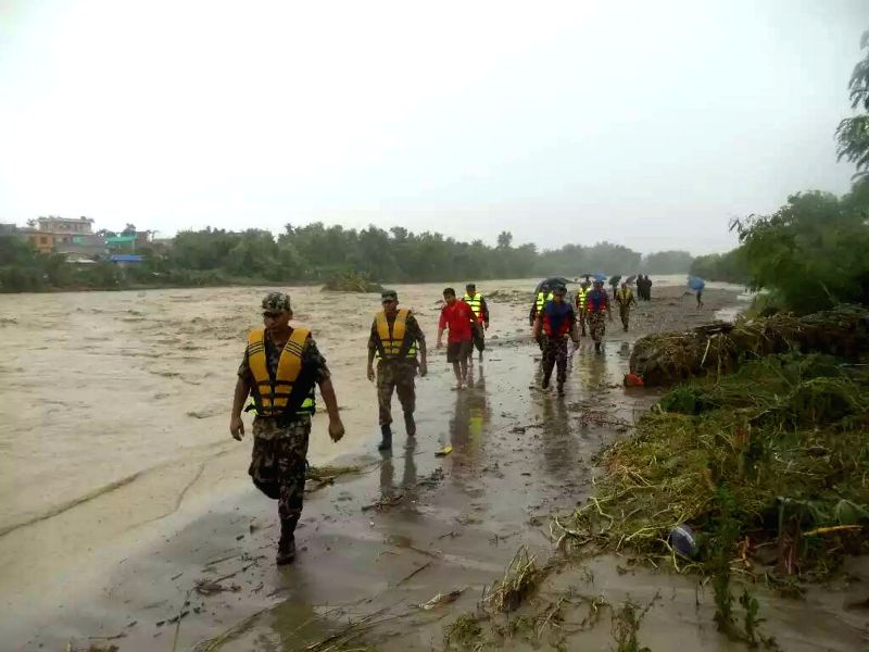 BIRATNAGAR, Aug. 12, 2017 - Rescuers evacuate resients suffered from flood in Biratnagar, Nepal, on Aug. 12, 2017. Monsoon-induced floods have created havoc across the low-lying areas known as Terai ...