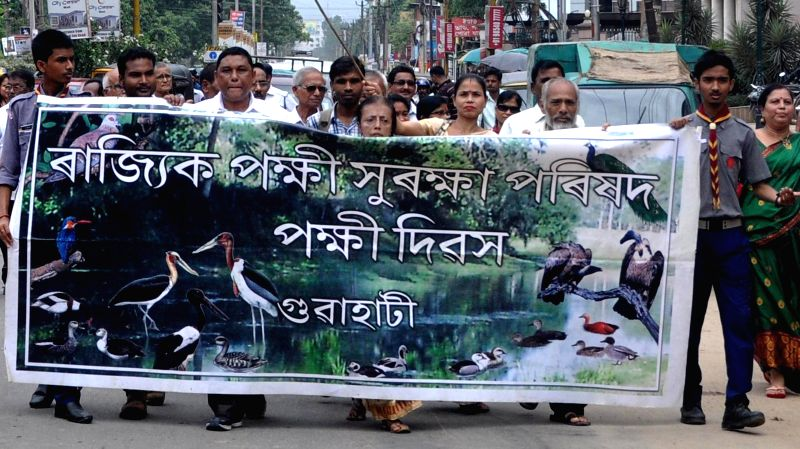 Bird lovers participate in an awareness rally organised by Pokhi Suraksha Parishad on 'Pokhi divas' in Guwahati on July 3, 2014.