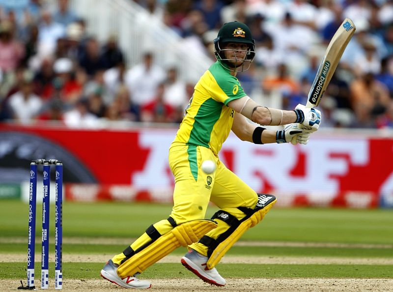 Birmingham: Australia's Steve Smith in action during the second semi-final match of the 2019 World Cup between England and Australia at the Edgbaston Cricket Stadium in Birmingham, England on July 11, 2019. Also seen England captain Eoin Morgan. (Pho