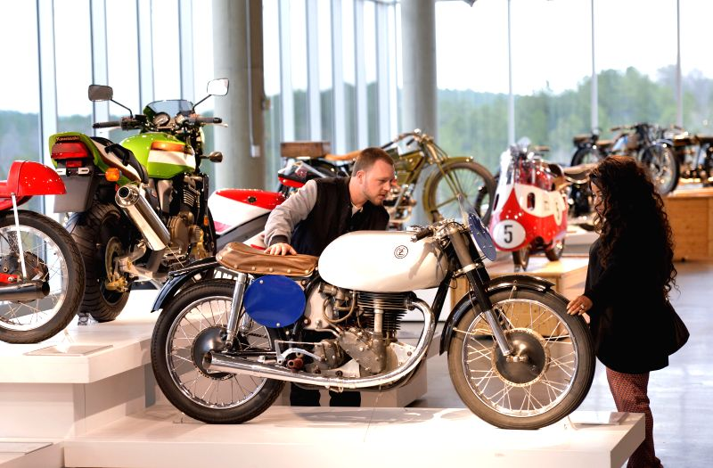 Visitors look around in Barber Vintage Motorsports Museum in Birmingham, Alabama, the United States, March 12, 2015. With a collection of over 1200 motorcycles, ...