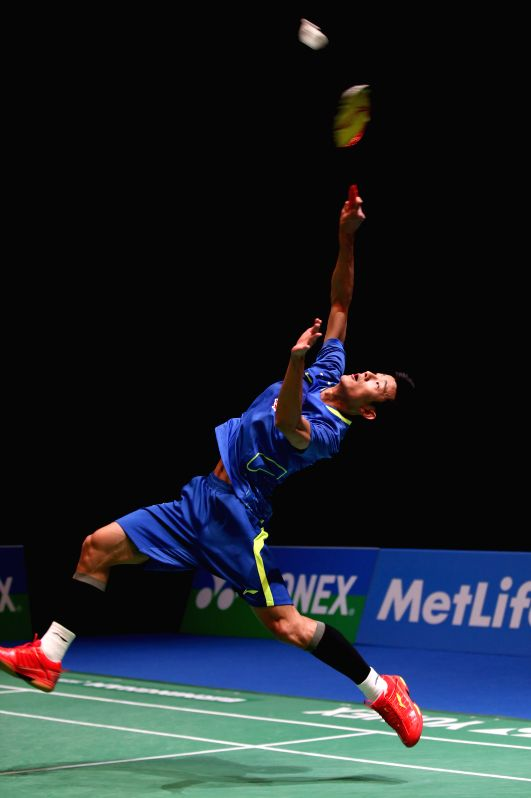 Chen Long of China returns the ball during the men's singles first round match against his teammate Xue Song at the All England Open Badminton Championships at ...