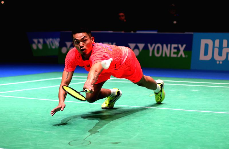 Lin Dan of China returns the ball during the men's singles first round match against Wei Nan of Hong Kong of China at the All England Open Badminton ...