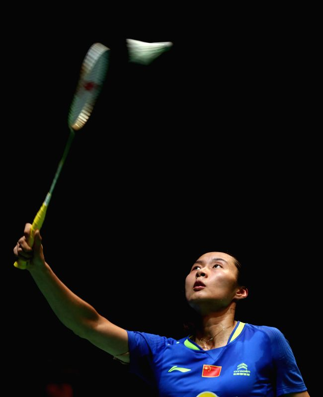 Wang Yihan of China returns the ball during the women's singles first round match against Nozomi Okuhara of Japan at the All England Open Badminton Championships ...