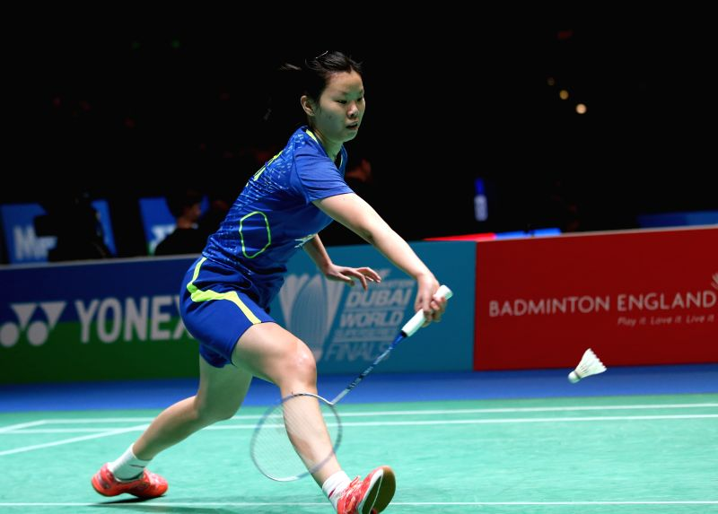 Li Xuerui of China returns the ball during the women's singles second round match against her teammate Sun Yu at the All England Open Badminton Championships at ...