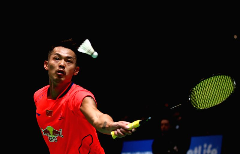 Lin Dan of China returns the ball during the men's singles second round match against his teammate Tian Houwei at the All England Open Badminton Championships at ...