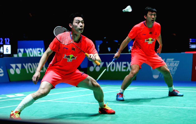 Qiu Zihan (R) and Liu Xiaolong of China compete during the men's doubles quarterfinal against Zhang Nan and Fu Haifeng of China at the All England Open Badminton ...