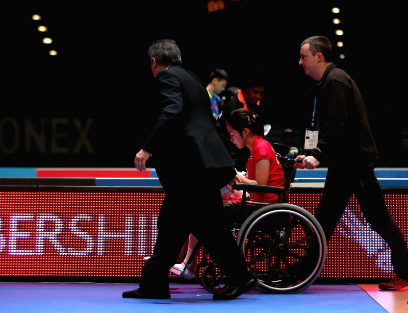 Ratchanok Intanon of Thailand leaves the court in a wheelchair after the women's singles quarterfinal against Sun Yu of China at the All England Open Badminton ...