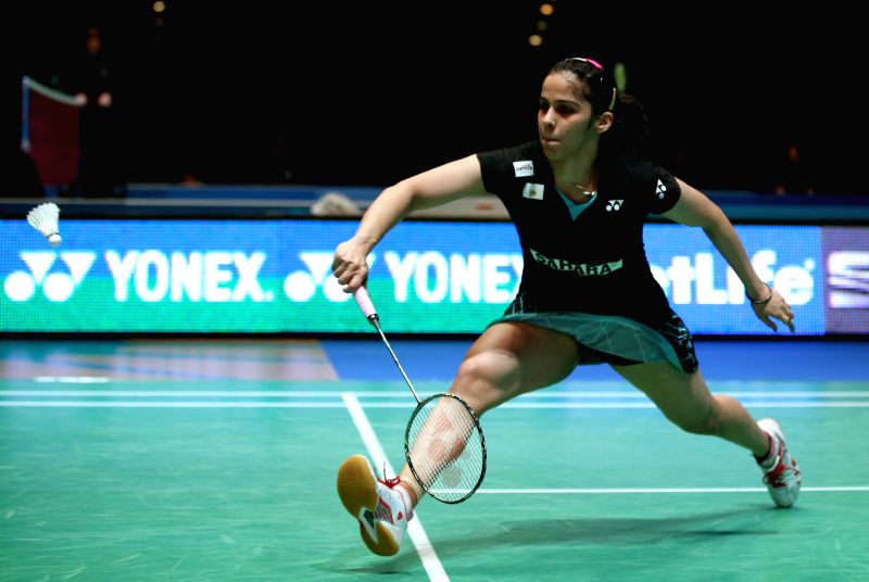 Saina Nehwal of India returns the shuttle during the women's singles quarterfinal against Wang Yihan of China at the All England Open Badminton Championships at ...