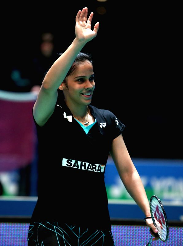 Saina Nehwal of India celebrates after the women's singles quarterfinal against Wang Yihan of China at the All England Open Badminton Championships at ...