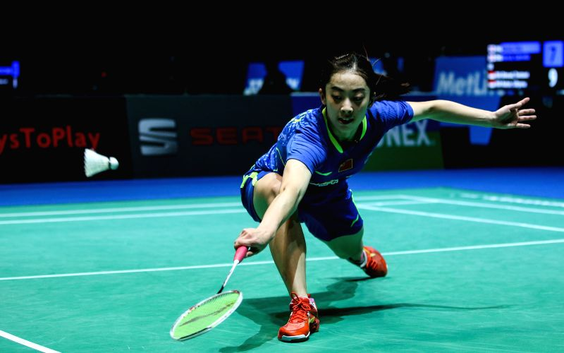 Wang Shixian of China returns the shuttle during the women's singles quarterfinal against Tai Tzu Ying of Chinese Taipei at the All England Open Badminton ...