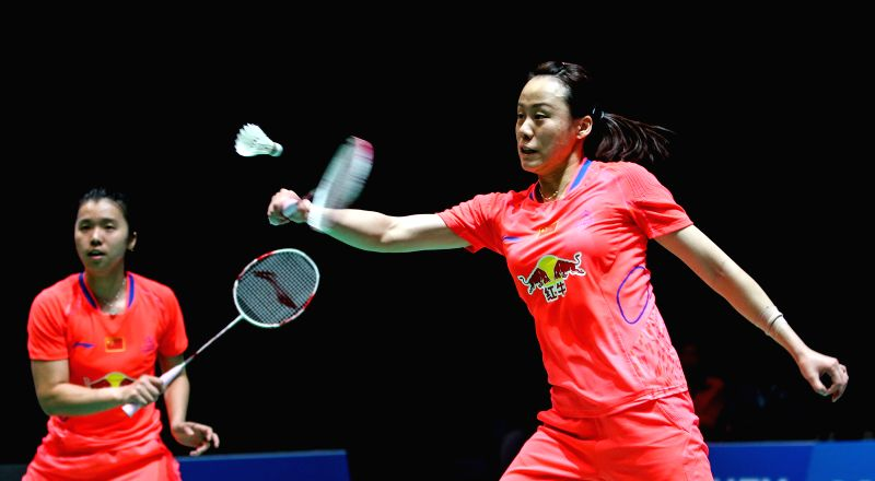 Zhao Yunlei (R) and Tian Qing of China compete during the women's doubles quarterfinal against Reika Kakiiwa/Miyuki Maeda of Japan at the All England Open ...