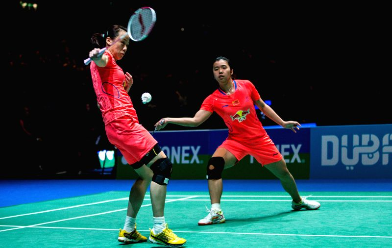 Zhao Yunlei (L) and Tian Qing of China compete during the women's doubles semifinal against compatriots Wang Xiaoli and Yu Yang of China at the All England Open ...