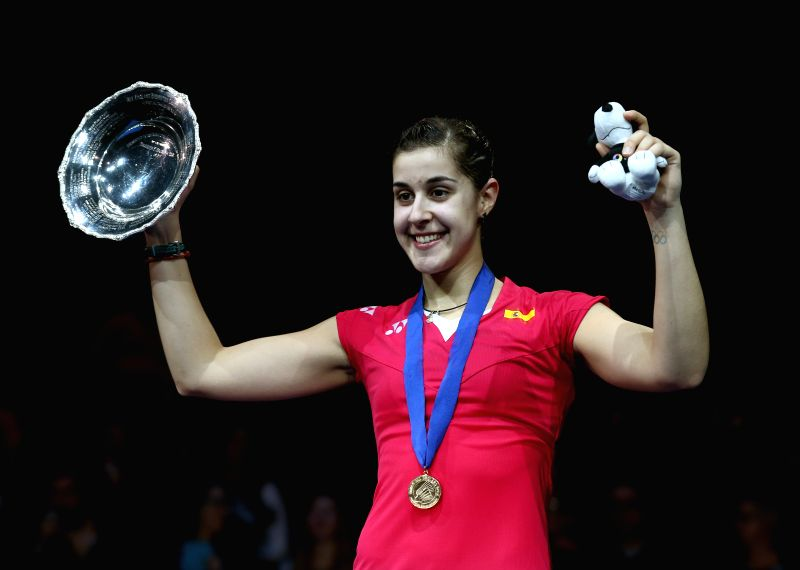 Carolina Marin of Spain celebrates on the podium after the women's singles final against Saina Nehwal of India at the All England Open Badminton Championships at ...