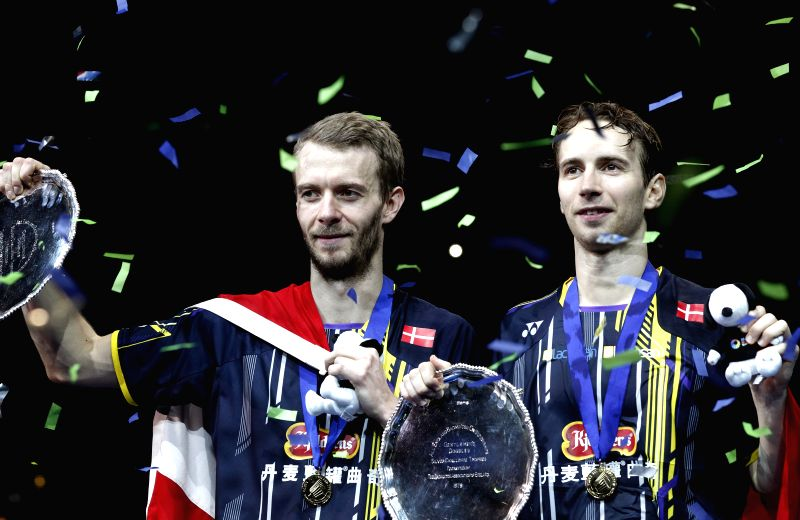 Mathias Boe (R) and Carsten Mogensen of Denmark pose on the podim after the men's doubles final against Fu Haifeng and Zhang Nan of China at the All England Open ...