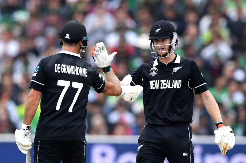 Birmingham: New Zealand's Jimmy Neesham and Colin de Grandhomme during the 33nd match of 2019 World Cup between New Zealand and Pakistan at Edgbaston Stadium in Birmingham, England on June 26, 2019. (Photo Credit: Twitter/@cricketworldcup)