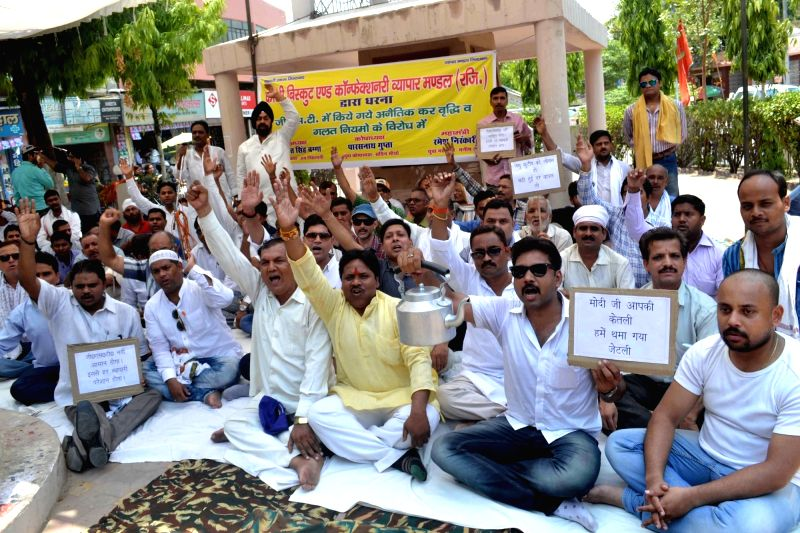 Biscuits and confectionery manufacturers stage a demonstration against GST in Varanasi on June 10, 2017.