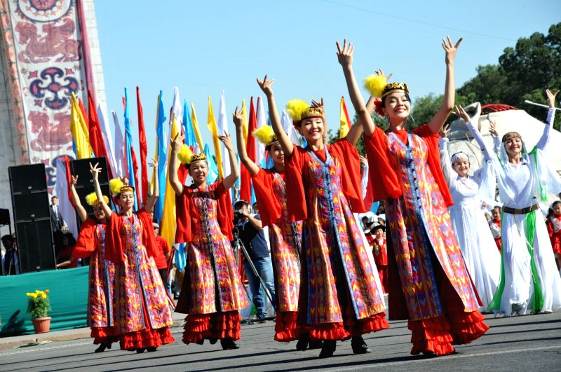 Dancers perform during the independence day celebration at Ala-Too Square in Bishkek, capital of Kyrgyzstan, on Aug. 31, 2014. Photo: