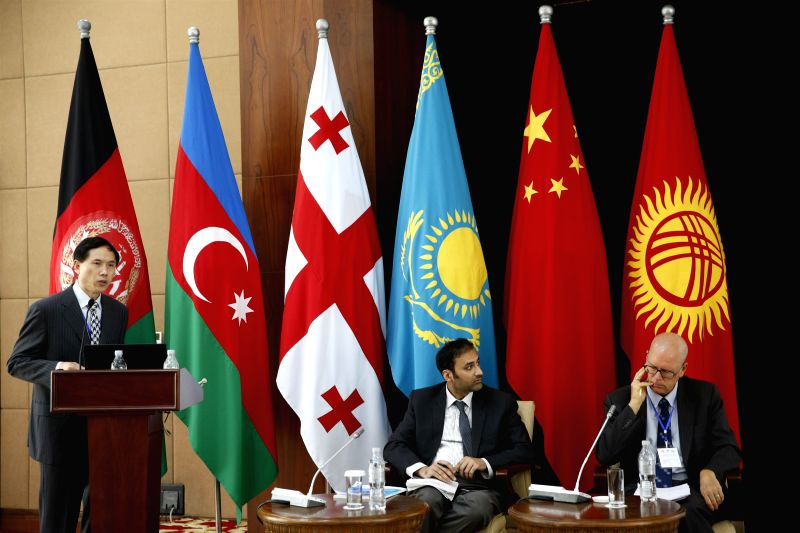 "BISHKEK, July 18, 2018 - Zhou Qiangwu (1st L), director of International Economics and Finance Institute, a think tank under China's Ministry of Finance, speaks at the ""Building knowledge ..."