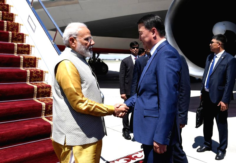Bishkek: Kyrgyzstan Prime Minister Mukhammedkalyi Abylgaziev welcomes Prime Minister Narendra Modi on his arrival in Bishkek, Kyrgyzstan to attend the meeting of the Shanghai Cooperation Organization (SCO) Summit 2019, on June 13, 2019. (Photo: IANS/