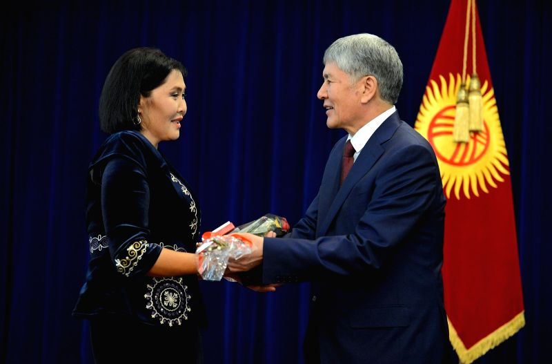 BISHKEK, May 14, 2016 - Kyrgyz President Almazbek Atambayev (R) awards a mother in Bishkek, Kyrgyzstan, May 14, 2016. Kyrgyz President Almazbek Atambayev on Saturday awarded mothers with many ...