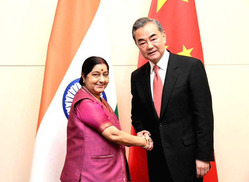BISHKEK, May 23, 2019 (Xinhua) -- Chinese State Councilor and Foreign Minister Wang Yi (R) meets with Indian External Affairs Minister Sushma Swaraj at a ministerial meeting of the Shanghai Cooperation Organization (SCO) in Bishkek, Kyrgyzstan, May 2