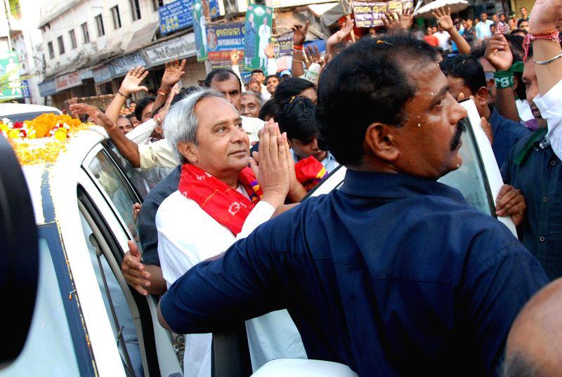 BJD president and Odisha Chief Minister Naveen Patnaik during a road show in Puri on April 11, 2014. (Photo : Arabinda Mahapatra/IANS)