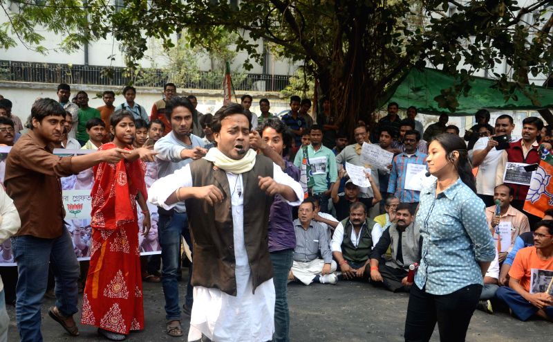 BJP activists stage a street play to demand proper investigation in the multi-crore Saradha chit fund scam in front of CBI office in Kolkata, on Dec 9, 2014.