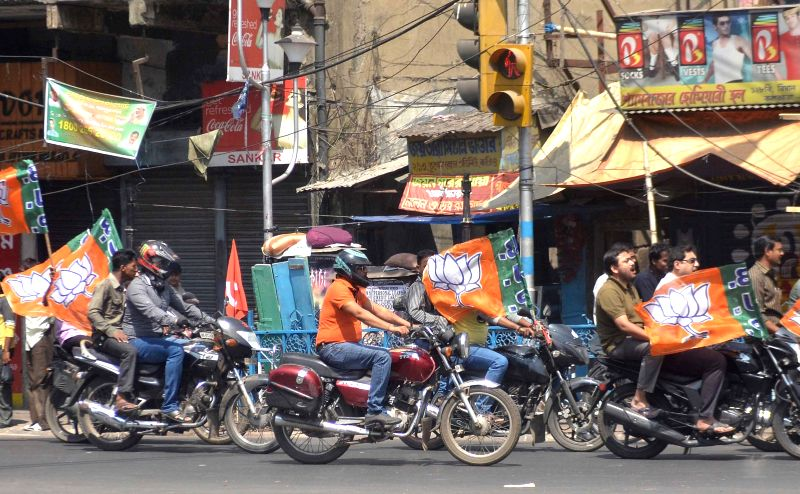 BJP activists take part in a bike rally while campaigning for Kolkata Municipal Election in Kolkata on March 22, 2015.