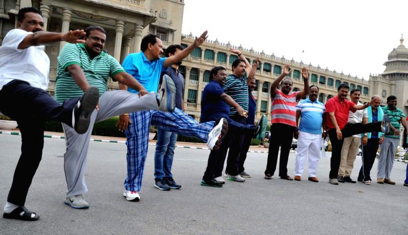 BJP and JD(s) legislators perform morning exercise during their protest to demand resignation of Karnataka Minister KJ George for his alleged involvement in the suicide of DYSP MK ... - K