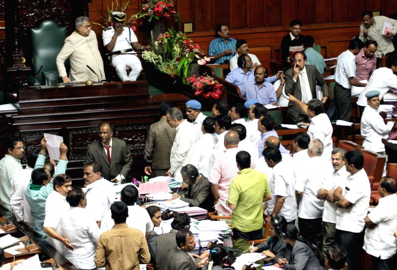 BJP and JD(s) legislators stage a demonstration to press for resignation of Karnataka Minister KJ George in connection with alleged suicide of Deputy Superintendent of Police MK ... - K