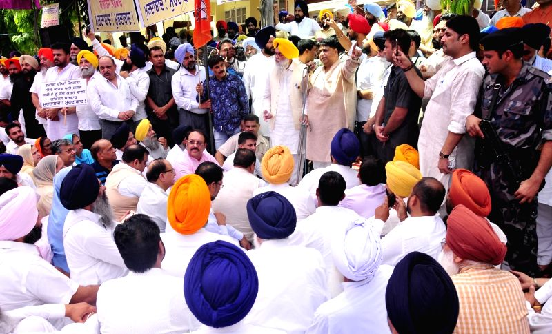 BJP and Shiromani Akali Dal activists stage a demonstration against Punjab government in Amritsar, on June 12, 2017.