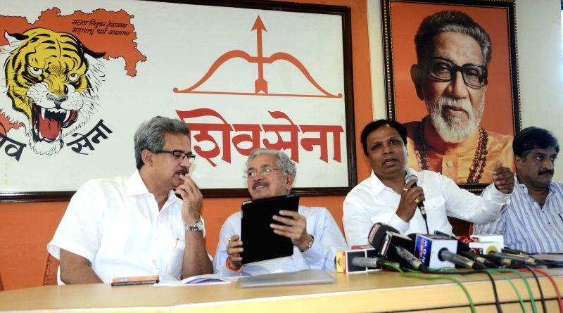 BJP and Shivsena leaders (L to R) Anil Desai, Subhash Desai, Ashish Shelar with Atul Shah addressing media at Shivsena Bhavan, Dadar in Mumbai on April 21, 2014. - Subhash Desai and Atul Shah