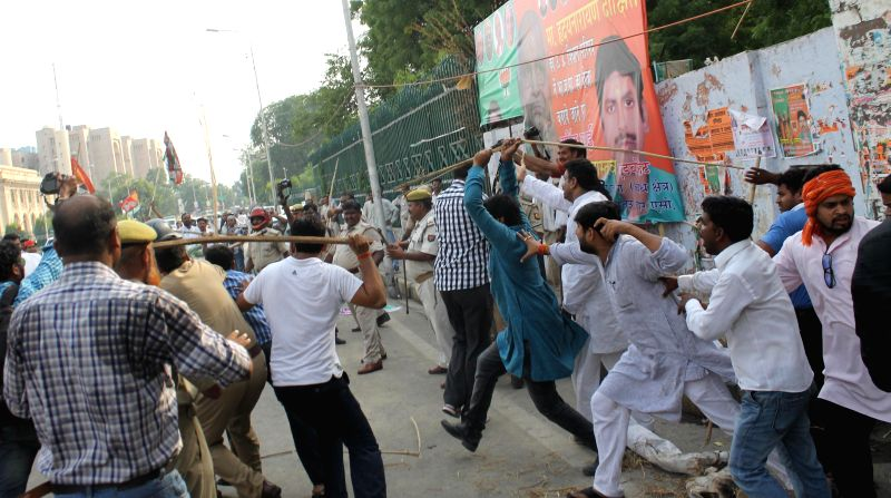 BJP and SP workers clash during a protest by SP workers on the railway fare hike in Lucknow on June 21, 2014.