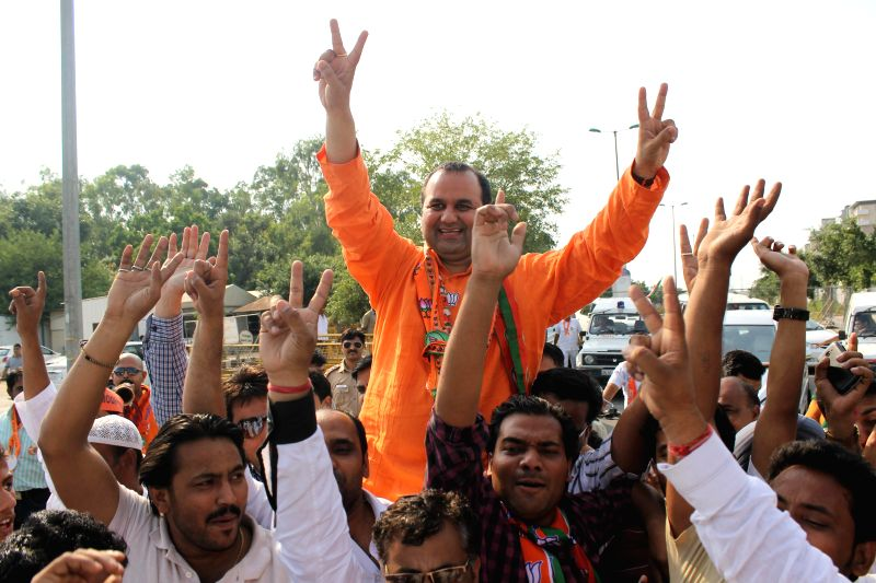 BJP candidate for 2014 General Election from East Delhi, Mahesh Giri celebrates after winning in New Delhi on May 16, 2014.