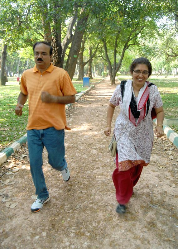 BJP candidate for Bangalore South Lok Sabha constituency Ananth Kumar and his wife Tejaswini Ananth Kumar during their morning walk at Lalbagh in Bangalore on April 19, 2014 (Photo : IANS) - Tejaswini Ananth Kumar