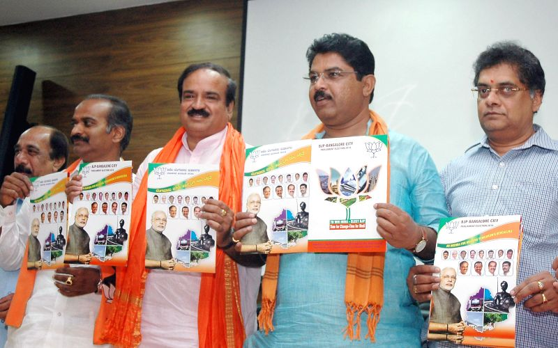 BJP candidate from Bangalore South for Lok Sabha election with other leaders releasing BJP's Bangalore development agenda in Bangalore on April 12. 2014.