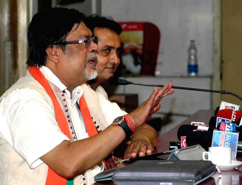 BJP candidate from Hooghly Lok Sabha constituency Chandan Mitra addressing media in Kolkata on April 12, 2014.