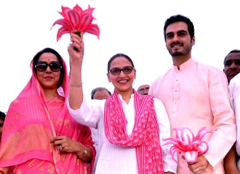 BJP candidate from Mathura, Hema Malini with her daughter actress Esha Deol and her husband Bharat Takhtani during campaigning for Lok Sabha election in Mathura on April 12, 2014.