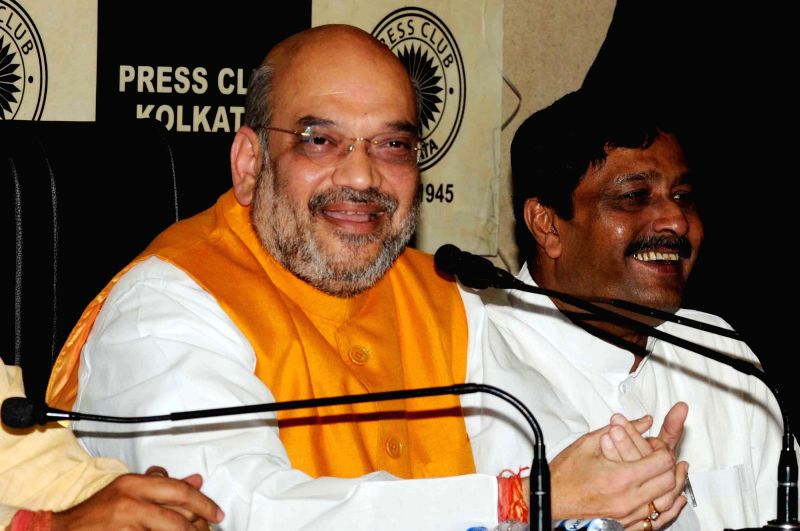"""BJP chief Amit Shah addresses a press conference in Kolkata on April 26, 2017. In an obvious attack on the Arvind Kejriwal government in the national capital, Shah said: """"The people of ... - Amit Shah and Arvind Kejriwal"""