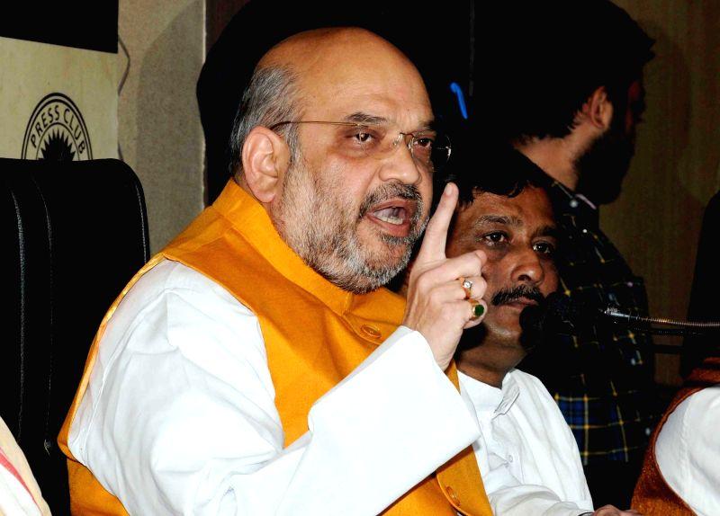 BJP chief Amit Shah addresses a press conference in Kolkata on April 26, 2017. Shah said the party's win in the Delhi civic polls was a vote in favour of Prime Minister Narendra Modi's three ... - Narendra Modi and Amit Shah