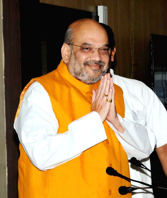 BJP chief Amit Shah addresses a press conference in Kolkata on April 26, 2017. Shah slammed the Congress for questioning the ruling party over its anti-Maoist strategy and said the Leftist ... - Amit Shah
