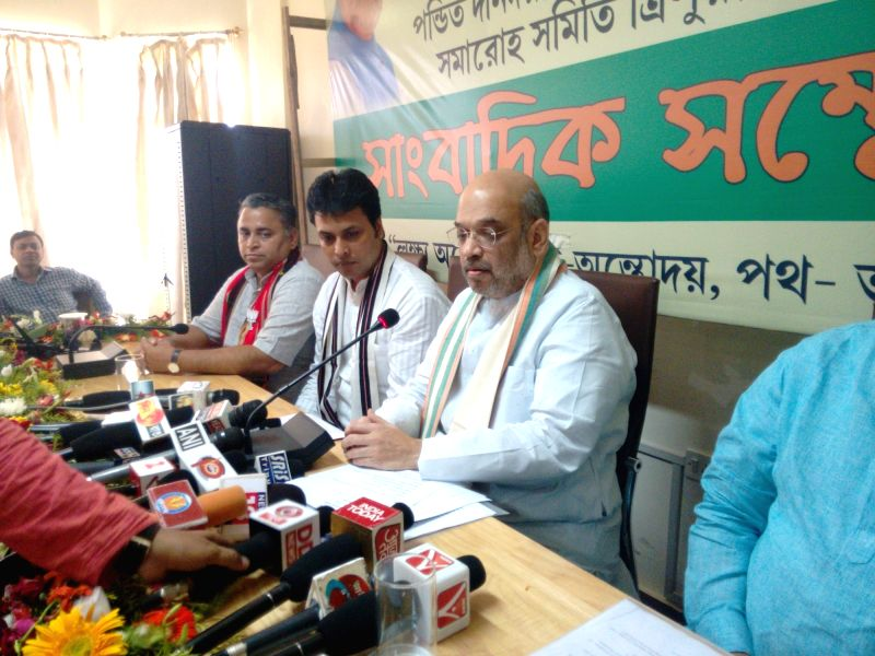BJP chief Amit Shah addresses a press conference in Agartala on May 6, 2017. - Amit Shah