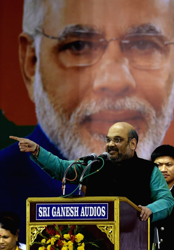 BJP chief Amit Shah addresses during a party programme in Chennai, on Dec 20, 2014.